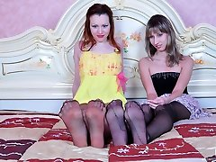 Foot-loving sapphos grind pantyhosed feet before some foot-to-pussy action