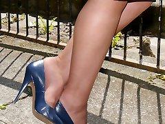 Stiletto Girl Lynsey is flashing her shiny nylon legs and high blue stiletto heels