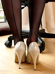 Sexy blonde Secretary Toni shows you around her home office in a pair of black nylons and cream stilettos
