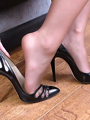 Michelle slips her foot in and out of her high heel shoe. As she gently kisses the heel you may...