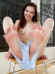 Ember Stone can't pick out what shoes to wear. Her boyfriend thinks anything open-toe will look good. She shows him her perfect feet and he gets so turned on. He sucks her toes and gets a footjob from her before pounding her little pussy hard. She cums over and over and then he blasts his load on her feet.