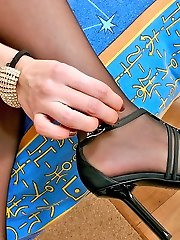 Lusty gal in stiletto heel footwear impatiently spreading her legs in black tights