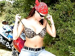 Babe with a red bandanna gets plowed on the back of a motorcycle