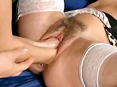 Hairy cunt whore brutally double fisted in her bucket snatch