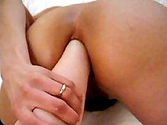 Horny brunette slut fist fucked in her poop chute