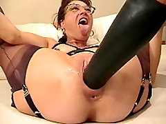 Kinky housewife gets fisted and fucked with a huge dildo