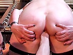 Submissive slave double fist fucked by her master
