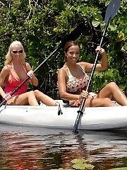 Check out these amazing hot ass big tits lesbians on a canoe lick and fuck their boxes after...