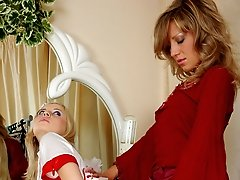 Lesbian maid spreads her love box for a strap-on cock aching to get a raise