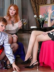 Kinky gal getting her pantyhosed clit massaged in steamy lesbian threesome