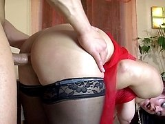 Well-hung muscle stud hikes up a milfs skirt probing her tight butthole