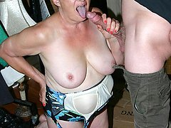 Pretty plumper granny Ginger Spice showing off her ample set of knockers and sucking a cock