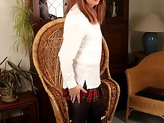 Luci is looking gorgeous in a tartan mini skirt and those long legs of hers go all the way up.