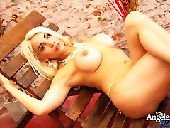 Blonde Bombshell Angeles Cid naked and squatting down