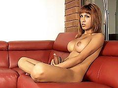 Hot Nathali tugging and masturbating her breasts