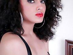 Beautiful sensual brunette in a corset shows her nude shedick