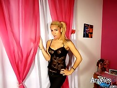 Horny Shemale Angeles Cid in a lace corset taking off her jeans