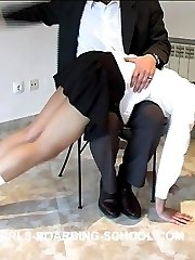 Innocent looking school girl bent over the chair and caned to tears on her bare bottom