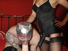 Strapon Jane thrusts her huge collection of strapons deep inside her gimps mouth and ass