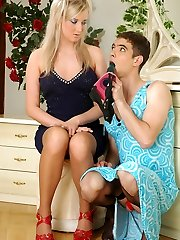 Cute sissy in a pretty blue sundress going after a lady with a cord-on cock