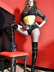 Female Dominance Strapon Jane plays with her huge strapon dinky dressed in fishnets, boots and yellow corset