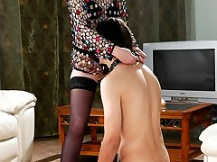 Dominative mistress spreads a guy�s cheeks aiming a strapon up his backdoor