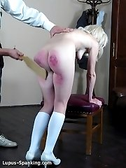 A heavy wooden paddle on her bare bottom.. again and again and again....