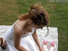 Girls lean forward and show cupcakes under blouses