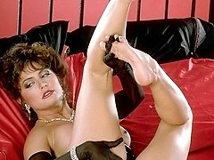 Ashlyn Gere in lingerie playing on a bed
