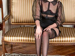 Becky strips to reveal her long nylon-ed legs and sheer red panties!