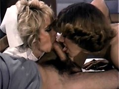 Two nurses sucking schlong