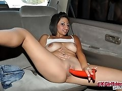 Exotic brunette exgirlfriend bitch Renee strips and fucks a long red dildo in the car