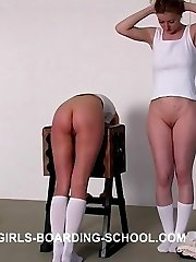 Pretty teens bent over whipping bench together for the cane