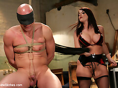 Sophie Dee makes her debut on Divine Bitches when she catches her husband continuously draining his pipe to latex clad dommes on the internet. Sophie teaches him a lesson he will never leave behind but only after she gets hers by using his dick HER way then making him eat his cum from her stocking feet. Chad is bound, spanked, flogged and paddled. He endures brutal Cbt by having multiple clothes pins and weights hung all along the sensitive skin of his penis followed by the apex of his beef whistle snapped shut with a mouse trap so he can never jism again.  He's fisted then rammed deep in his ass with a cable-on cock. Chad's punishment will proceed with his ultra-kinky bone locked away in chastity forever while the keys remain on a chain nestled between Sophie's purrfectly large udders.