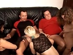 German swingers having fun at a sex party in a private swing club