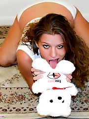 Chubby young lingerie model stripping at the pole
