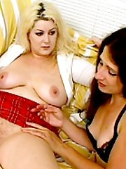 Gorgeous fatties pleasure each other with dildo
