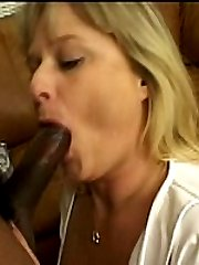 Black cock buried deep in blonde plumper's pussy