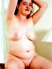 Sexy little chubby spreads her pink open