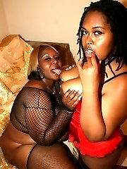 Big floppy tits on two black fatties get their pussies wet