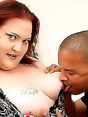 Redhead fatty enjoying a huge black cock