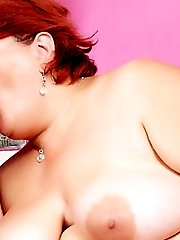 Hefty redhead Hilda performs excellent oral before she gets screwed and showered with sticky goo