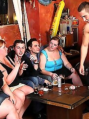 The horny fat chicks drink with their men and then we watch one of them bend over for it