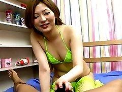 Cutie Japan girl in fishnets Shiho Kano gives handjob and blowjob on camera