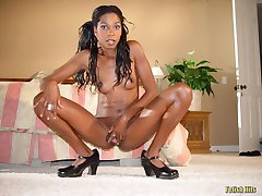 Sexy ebony teen babe poses and shows pink in bed