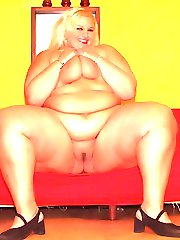 Sultry fat blonde Melinda Shy strips off her clothes for the camera and kneading her rack