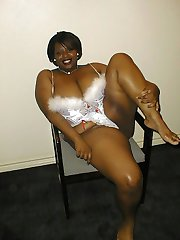 Kandace is a very hot, flexible big black woman.  Cum see her wearing some immensely sexy lingerie and being very naughty with her toys