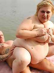 Busty chick Cynthia pumps her bbw pussy full of a huge cock in this outdoor lake fucking