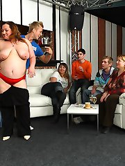 The horny fat girls at this bar party get naked and give blowjobs to the slender guys with them
