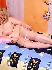 Light-haired teen plumper stripping for fun